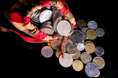 Bag of multiple coins | Black Background Royalty Free Stock Images