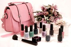 Bag and nail polish. Desatured effect bags and nail polish with dried flowers - filtered image Stock Photo