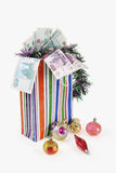 Bag with New Year's toys and denominations Royalty Free Stock Image