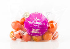 Bag of Nightingale Farms cherry tomatoes from Tesco.. WREXHAM, UK - MAY 24, 2017: Bag of Nightingale Farms cherry tomatoes exclusively for Tesco on a white Stock Photography