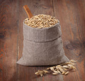 Bag of oats on the boards Royalty Free Stock Photography