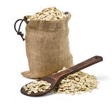 Bag of oats and a wooden spoon Royalty Free Stock Photos