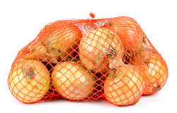 Bag of onions isolated on white royalty free stock photography