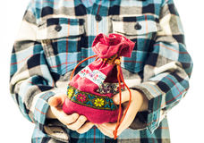 Bag in open child palms Stock Photo