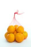Bag of Oranges. Oranges in a plastic meshed bag Royalty Free Stock Image