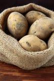 Bag of organic potatoes Stock Photos