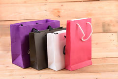 Bag. Paper shopping bags isolated on wood background Royalty Free Stock Photo