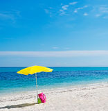 Bag, parasol and sea Royalty Free Stock Images