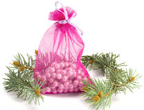 Bag with pearls and a fur-tree. On the white isolated background Royalty Free Stock Images