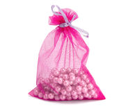Bag with pearls on a white background Stock Images