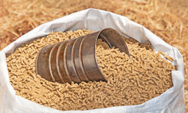 Bag of pelleted horse feed Stock Photos