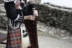 Bag pipe and scottish kilt Stock Image