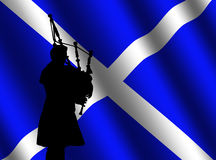 Bag piper with Scottish flag Stock Photography