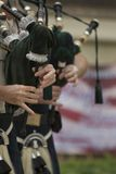 Bag pipes. Bagpipes are a class of musical instrument, aerophones using enclosed reeds fed from a constant reservoir of air in the form of a bag stock photo