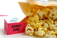Bag of popcorn. With ticket stub closeup Stock Photography