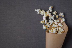 Bag with popcorn. Paper bag with cooked popcorn removed from above Royalty Free Stock Photo