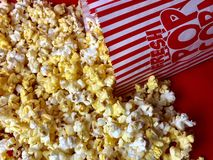 Spilled bag of popcorn royalty free stock photography
