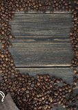A bag of roasted arabica coffee beans. On a dark wooden background with a free space top view Stock Photography
