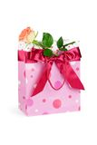 Bag with rose. Pink bag with rose and satin bow. Isolated on white Royalty Free Stock Photos