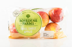 Bag of Rosedene Farms small sweet apples from Tesco. WREXHAM, UK - MAY 24, 2017: Bag of Rosedene Farms small sweet apples exclusively for Tesco on a white Royalty Free Stock Photos