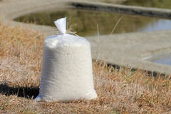 Bag of salt in the marshes Royalty Free Stock Photos