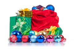 Bag of Santa Claus with gifts on white Stock Images