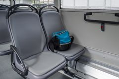 A bag on the seat in bus royalty free stock image