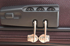 Bag security. Close up on locking mechanism on luggage zip. Concept of security requirements when travelling Stock Photos