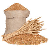 Bag and a sheaf of wheat. On white Stock Images