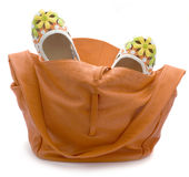 Bag and shoes. Leather orange bag and shoes-flowers isolated on a white background Stock Photo