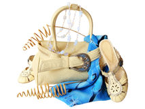 Bag, shoes, pareo, beads, isolated on white. Beige bag and shoes, blue pareo, moonstone beads, dried branches, isolated on white Stock Photos