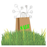 Bag for shopping on a white background in the. Green grass,for advertising stock illustration