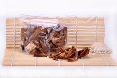 A bag of sliced ganoderma--a traditional chinese medicine Royalty Free Stock Photos