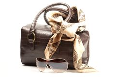 Bag, spectacles and scarf. Brown bag, spectacles and scarf on the white background Royalty Free Stock Photography