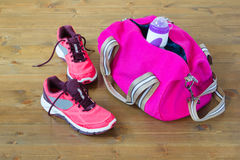 Bag for sporting on the floor. Pink bag with things for sports lies on the floor Stock Photos