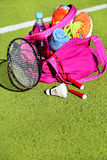 Bag with sports equipment on the sports courts background. Royalty Free Stock Photography