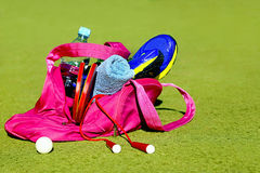 Bag with sports equipment on the sports courts background. Stock Photo