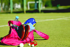 Bag with sports equipment on the sports courts background. Royalty Free Stock Images