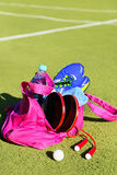 Bag with sports equipment on the sports courts background. Stock Photography