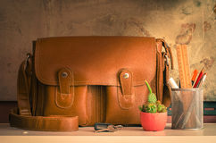 Bag and stationary on table. Still life of bag and stationary on table at home Stock Photos