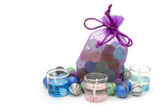 Bag with stones and candles isolated over white Royalty Free Stock Photo