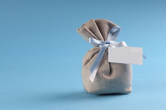 Bag with sugared almonds for a new birth with copyspace Royalty Free Stock Photos