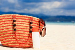 Bag, sun glasses and suncream on the beach Royalty Free Stock Photos