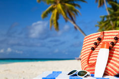 Bag and sun glasses on tropical beach Stock Images