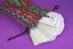 Bag of Tarot Cards. The back of a deck of tarot cards in colorful bag Stock Photos