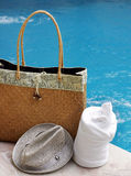 Bag and towel by pool Royalty Free Stock Photo