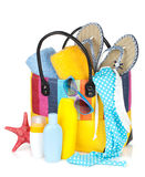 Bag with towels, sunglasses, flip-flops and beach items Royalty Free Stock Photos