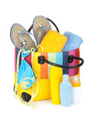 Bag with towels, sunglasses, flip-flops and beach items Stock Photo