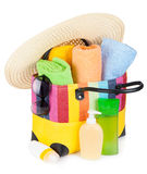 Bag with towels, sunglasses, hat and beach items Royalty Free Stock Image