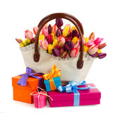 Bag  of tulips flowers  with gift boxes. Bag   of spring  tulips flowers with gift boxes   isolated on white background Stock Photos